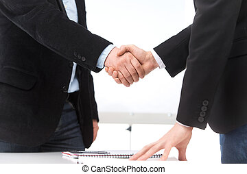Business people shaking hands in office businessman shaking...