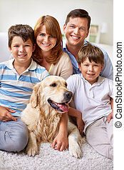 Family with dog - Happy family posing with their dog
