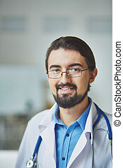 Male doctor - Portrait of a confident gp smiling at camera