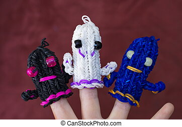 Loom band ghosts - A child's hand decorated with original...