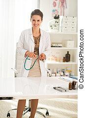 Portrait of doctor woman in office