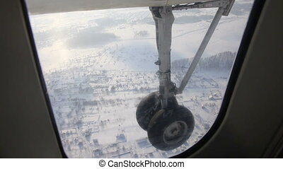 Plane gear - Plane landing. A plane gear. A view from the...