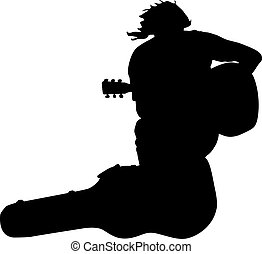 Silhouette musician guitar player sitting on the case....