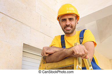 Handsome young bearded workman