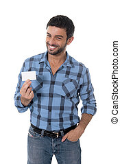 man showing and pointing blank business card smiling happy -...