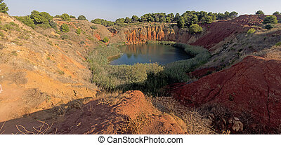 Bauxite Mine with Lake at Otranto Italy - Bauxite Mine with...
