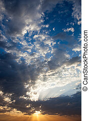 Cloudscape with the sun rays radiating from behind the cloud
