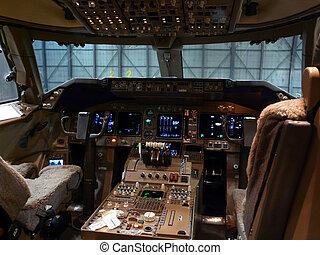 dark cockpit - a dark cockpit of a modern jet plane