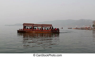 The travel boat float at West Lake - The travel boat float...