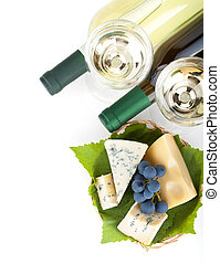 White wine, cheese and grape. Closeup. View from above....