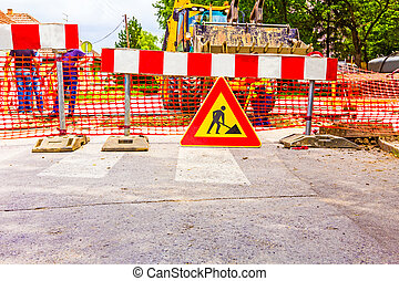 Road works - Road signs in a street, under reconstruction...