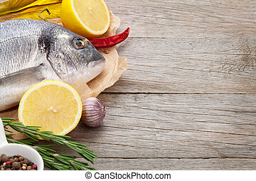 Fresh dorado fish cooking with spices and condiments on...