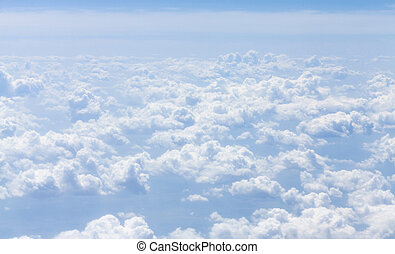 Blue sky with clouds background View from airplane