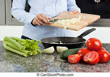 Woman cooking dinner - Young woman cooking healthy tasty...