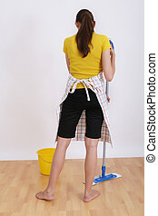 woman sweeping the floor with a domestic broom