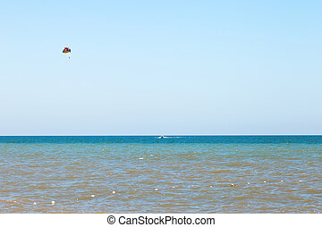 Parasailing over water Sea of Azov, Golubitskaya, Russia