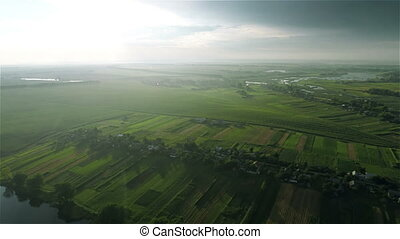 Village and fields with a birds-ey - Aerial shot: Village...