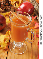 Hot apple cider - a cup of hot apple cider with a cinnamon...
