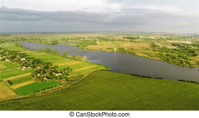 Flying over river and fields - Aerial shot: Flying over...