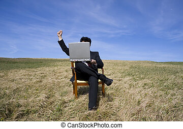 Celebrating - Business man sitting on a chair working out