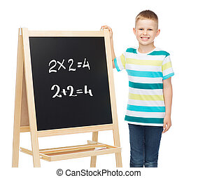 smiling little boy with blank blackboard - people, childhood...