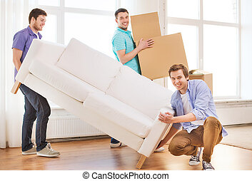 smiling friends with sofa and cardboard boxes - repair,...