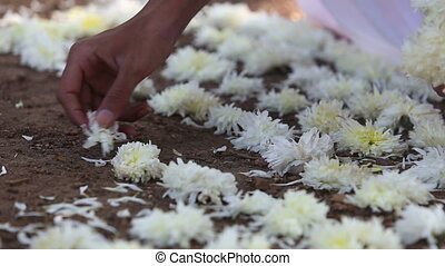Brahmin lays flowers at the Indian ceremony near the sacred...