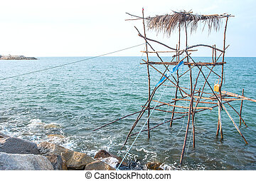 Traditional fishing method using a bamboo square dip net at Sout