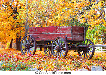 Old Wagon - Old red Wagon with autumn trees background