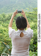 Imaging with mobile - RATCHABURI, THAILAND - JUNE 24, 2014 :...