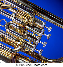 Tuba Euphonium Isolated on Blue - A gold brass tuba...