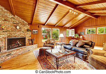 Luxury log cabin house interior. Living room with fireplace and