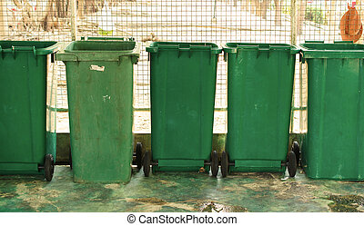 overfilled trash of large bins for rubbish, recycling and...