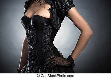 Close-up shot of an elegant woman in Victorian style corset...