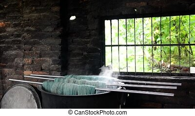 Wool dyeing in Nepal - Wool dyeing in a carpet factory,...
