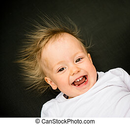 Smiling baby portrait - Portrait of laughing baby with...