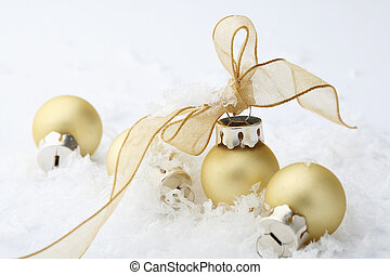 Gold Christmas bauble decorations with ribbon. - A close-up...