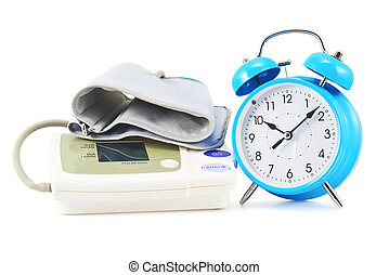 Alarm clock next to sphygmomanometer - Blue alarm clock next...