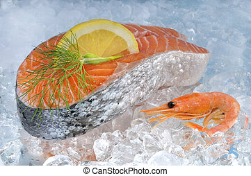 Seafood - Fresh salmon steak and shrimps on ice