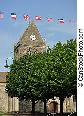 Sainte-Mere-Eglise - Ste-Mere-Eglise Church and flags of the...