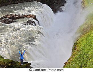 The woman over water chasm - The delighted woman - tourist...