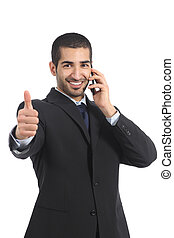 Arab businessman on the mobile phone with thumb up