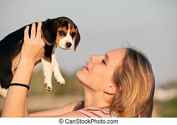 woman with pet beagle dog - woman owner with pet beagle dog