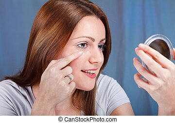 Anti-wrinkle cream - Young woman applied anti-wrinkle cream
