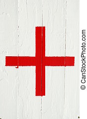 Emergency cross sign - red emergency cross on a white wooden...