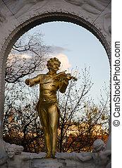 Johan Strauss statue in Vienna garden, Austria