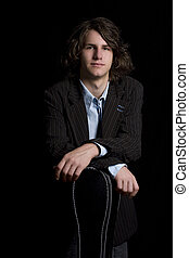 Teen Guitar player - portrait of a male teenager wearing a...