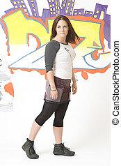 Walking in front of a graffiti - Teen girl walking in front...