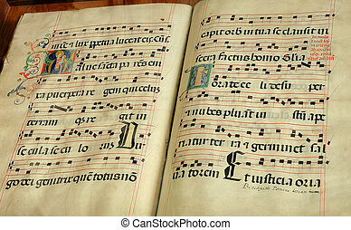 old religious book - Vintage religious music book with dots...