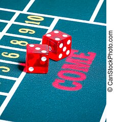 Two red dice on green gambling game